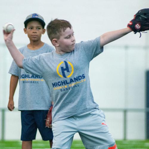 Boy throwing baseball