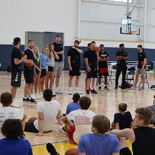 Boys listening to a basketball team