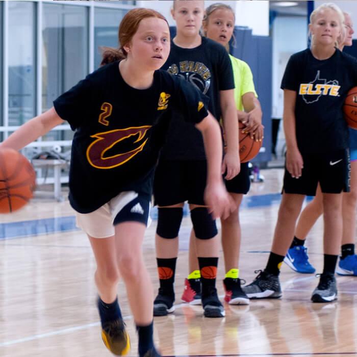 Girl dibbling the basketball