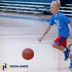 Person dribbling basketball