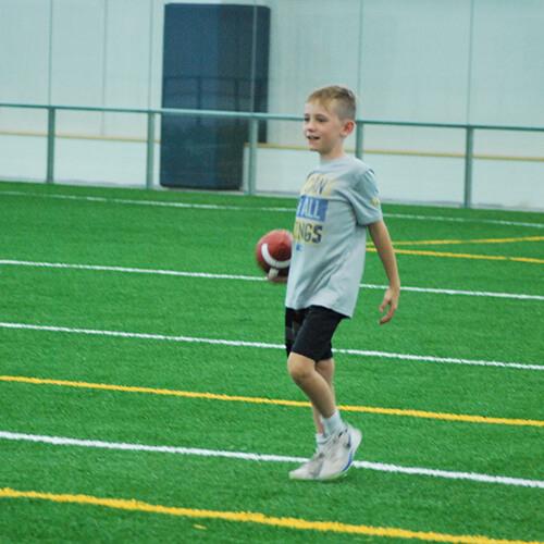Boy holding the football