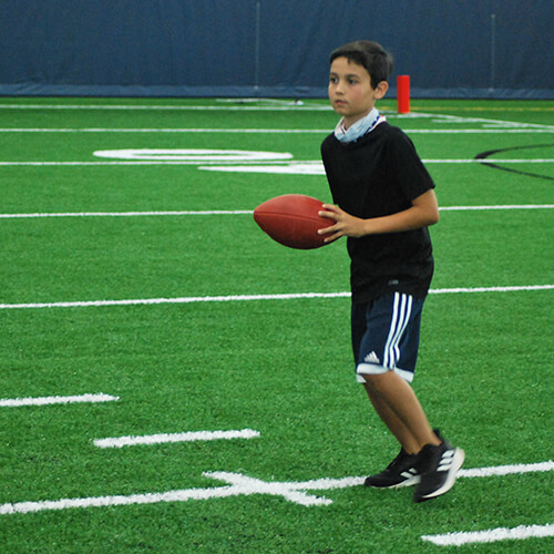 Boy about to kick the football