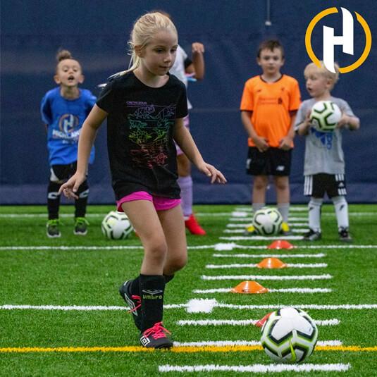 Person kicking a soccer ball