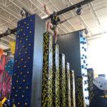 Person on big pillars climbing at highland sports complex