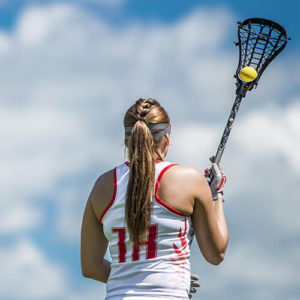Girl holding lacrosse stick
