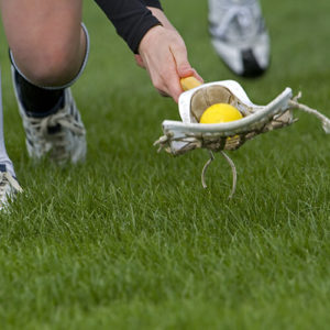 Picking up the ball with a lacrosse stick