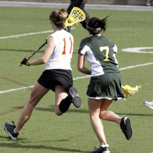 People holding the lacrosse stick