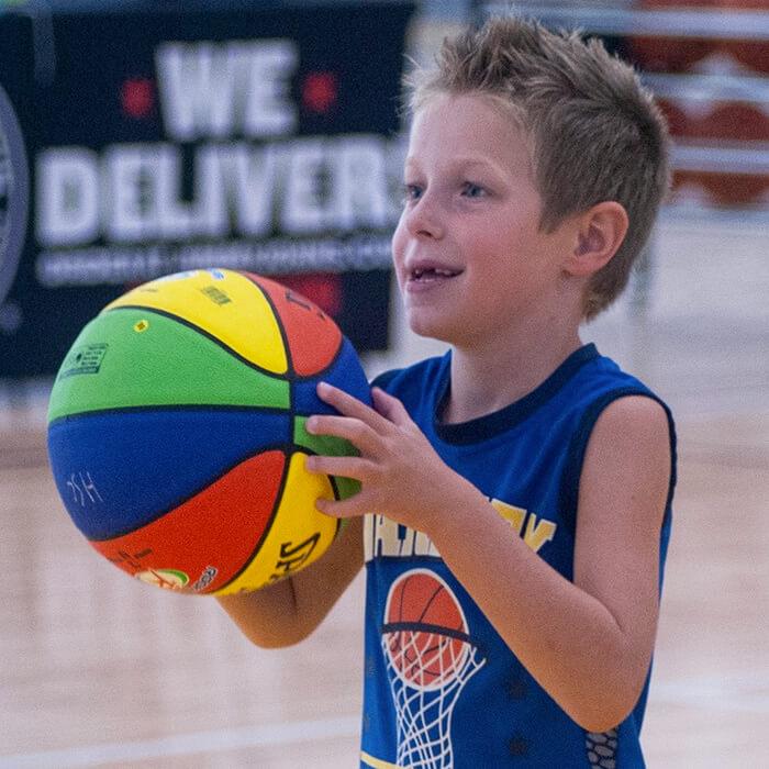 Boy shooting the basketball