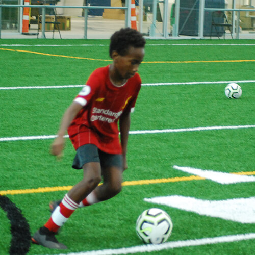 Person about to kick the soccer ball
