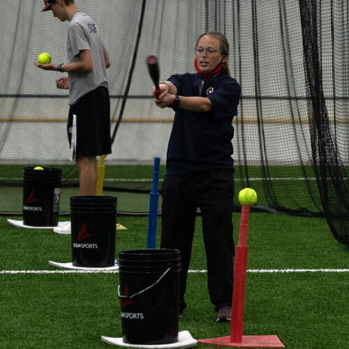 Girl swinging the softballbat