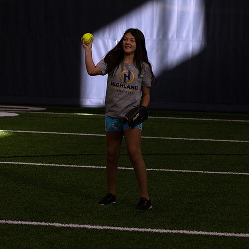 Girl holding a softball