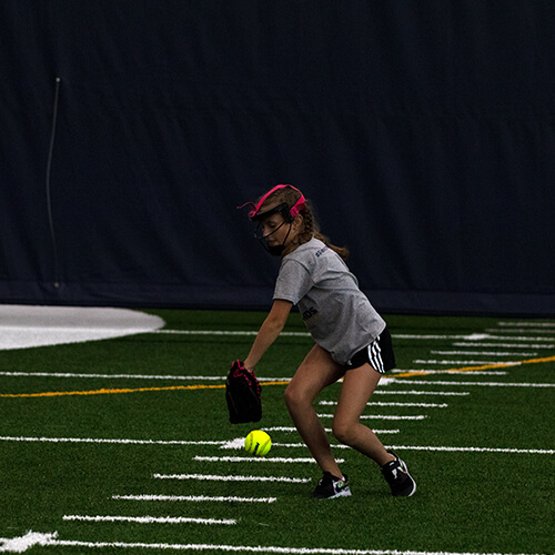 Girl`trying to catch softball