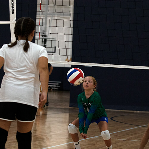 Girl about to hit volleyball