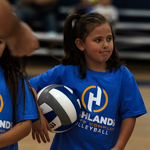 Girl holding volleyball