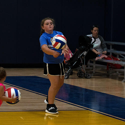 Girl about to hit the volleyball
