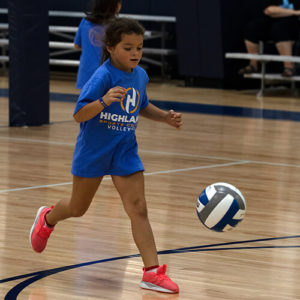 Girl running to get the volleyball