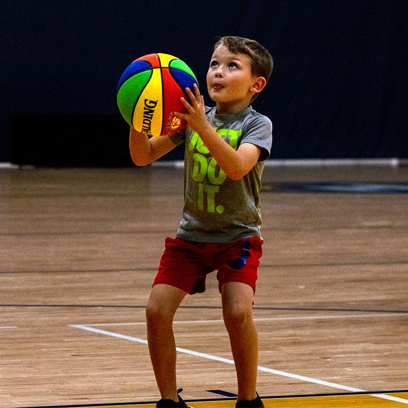 Boy throwing the basketball