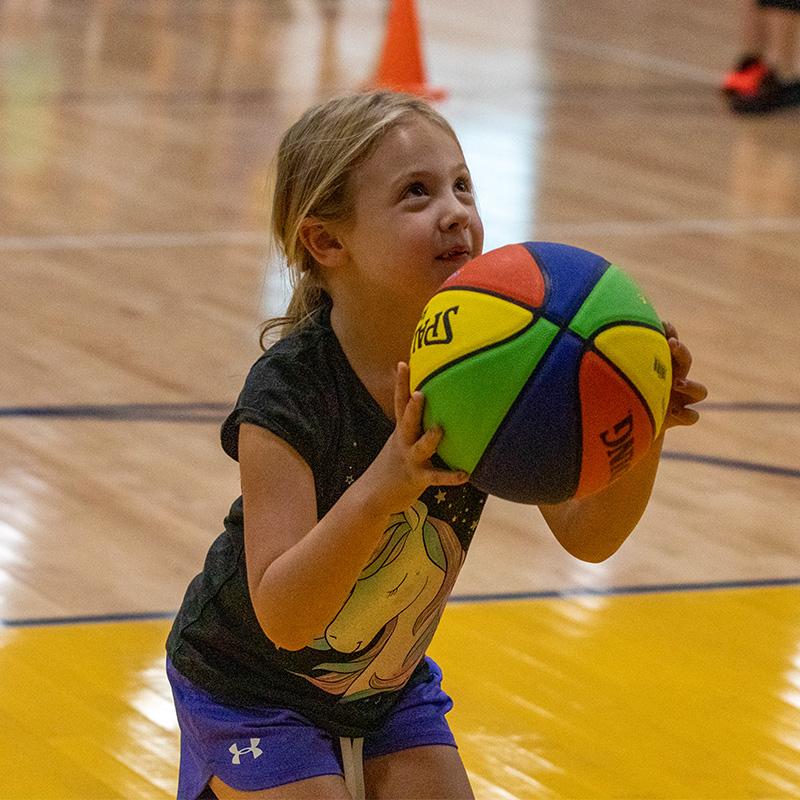 Girl throwing the basketball