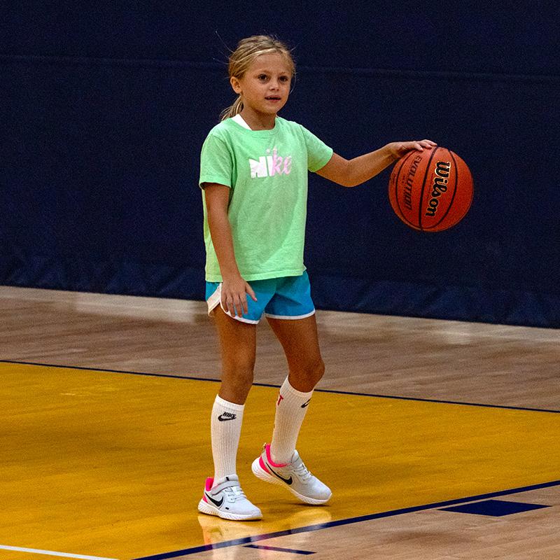 Girl dibbling a basketball