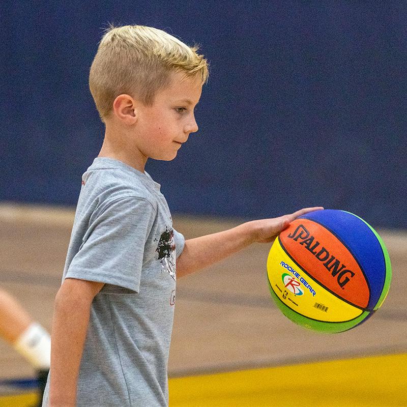 Boy dibbling the basketball