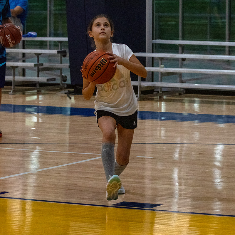 Girl about to throw the basketball