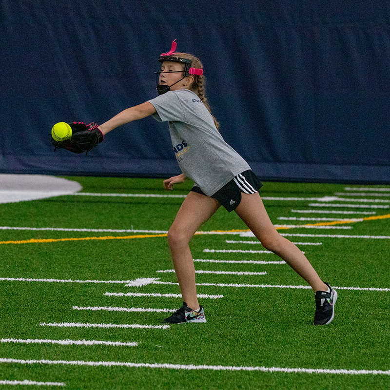 Person wearing a glove ready to catch the ball