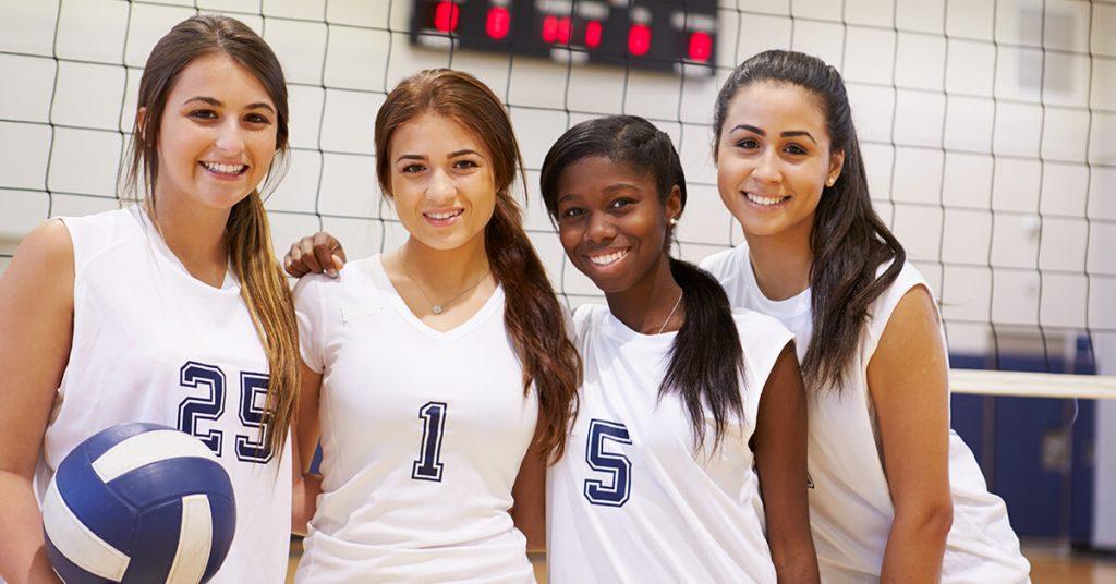 High School Girls playing Volleyball