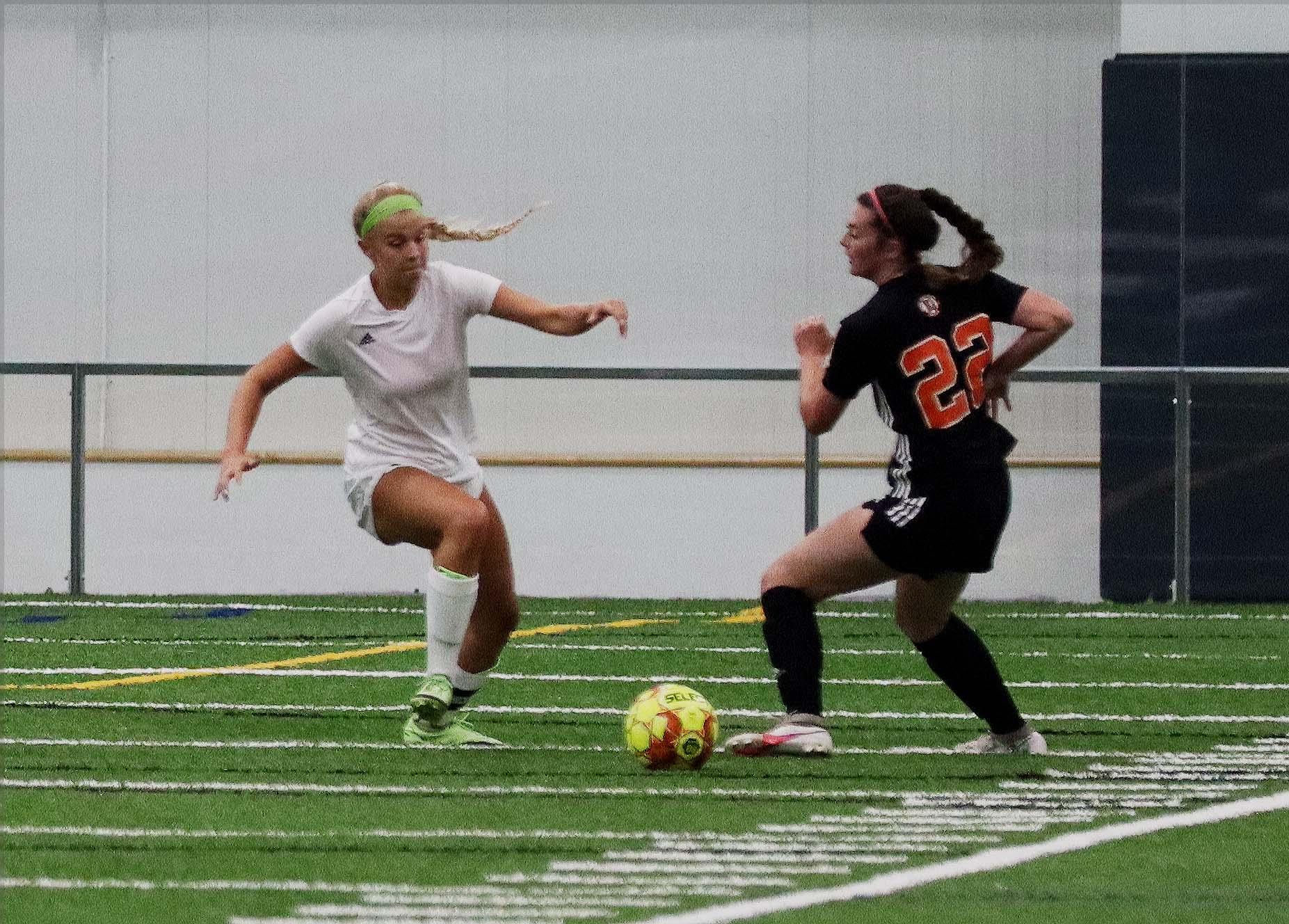 women playing soccer